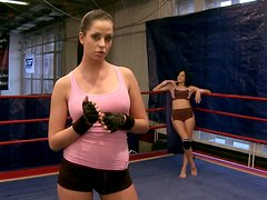 Tow sporty babes show martial art tricks on the boxing ring