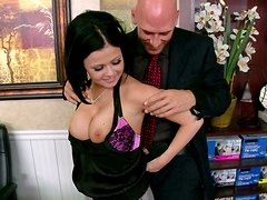 Bald dude squeezes Loni Evans's appetizing tits and gets a great blowjob