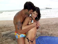 Handsome macho eats Fabiany Dellaveingh on the ocean beach