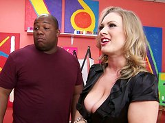 Curvaceous blonde MILF Vicky Vixen blows BBC at the art gallery