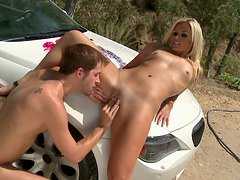 Pale blond head Kaycee Brooks gets her pussy licked on the car hood