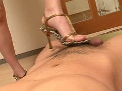 Long haired brunette Ishiguro Kyok gives a foot and mouth job to a hot tool