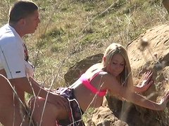 Skinny blonde chick Casi James fucked doggystyle near the rock.
