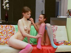 Two young redhead divas masturbating and fucking a pink dildo