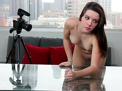 Pretty brunette Natalie is poked badly on a glass table