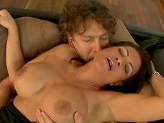 Mature brunette Teri Weigel sucks strong and young dick