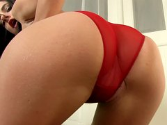 Hot brunette in red panties plays solo on the coach