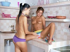 Two sporty babes get naked and play erotic games