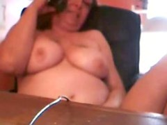 My mum rubbing pussy at telephone. Hidden cam