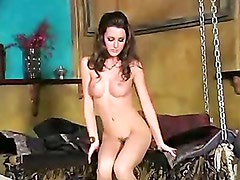 Erica Ellyson gets naked and shows teasing moves on the scene