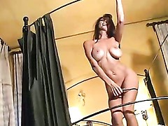 Busty babe Sunny Cruz gets wet and hot in her room