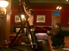 Sexy Iona Grace gets hanged up to the ceiling and whipped