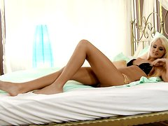 Ivana moans in pleasure while fingering her pussy in the morning