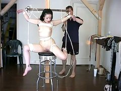 Brunette siren gets hogtied and hanged for some pain