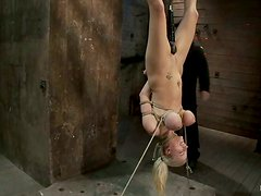 Stunning blonde gets hanged upside down and humiliated