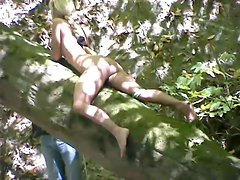BDSM session outdoors in the woods with Janay