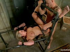 Busty blondie gets chained and penetrated doggy style