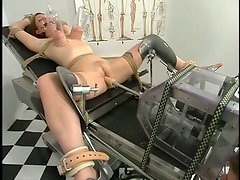 Tied up Dusty gets her pussy toyed and clothespinned