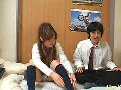 Japanese girl in school uniform fucks a guy after watching porn