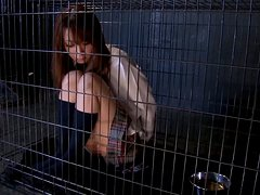 Beautiful Japanese girl sucks two dicks in a cage