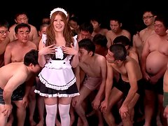 A lot of hungry dudes surround this petite Japanese maid