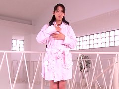Hitomi Honjou the sexy babe in a swimsuit sucks two cocks