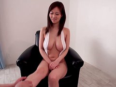 Japanese girl with big boobs poses for the camera