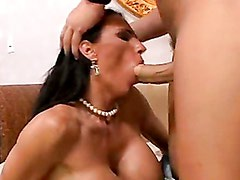 Scorching momma Lisa Lipps thumps a massive cock in her mouth like a sausage