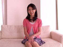 Hot Hitomi Honjou rubs her hairy pussy lying on a sofa