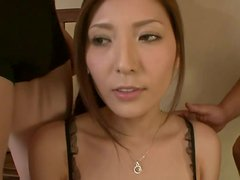 Submissive Japanese babe sucks and rides two dicks