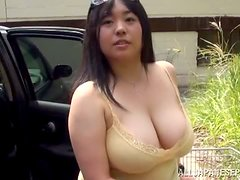 Chubby Japanese milf pleases some guy with a titjob outdoors
