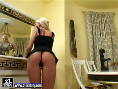 Dorina smashes her holes with a dildo and pours milk on her body
