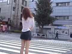 Kinky Japanese girl shows off her butt in the street