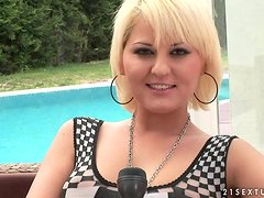 Blonde hottie Antynia Rouge gives an interview on the poolside