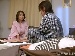 Mio Takahashi the busty Japanese gives a titjob