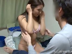 An amateur Asian couple are feeling frisky at home