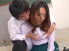 This filthy teacher looks like she's not enjoying being groped