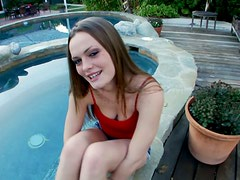 Monica Rise gives a handjob to some lucky man on the poolside