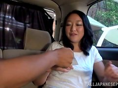 Japanese milf gets her hairy cunt fingered in a car