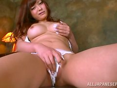 A sexy Japanese doll goes at it all alone