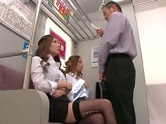 Two amazing Japanese girls have threesome sex on a train