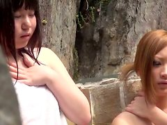 Two slutty Japanese girls get fucked in an outdoor jacuzzi