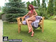 Redhead Sonya toys her hot pussy with black dildo