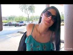 Nasty Lilly shows her seductive boobs in the street