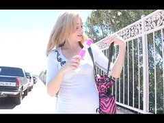 Maelynn enjoys her pink dildo sitting at the stairs in the street