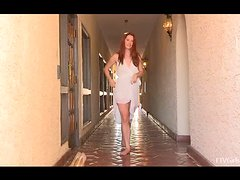 Gorgeous young Melody is walking naked on the street