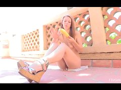 teen Lacie is masturbating with a squash outdoors
