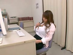 Hitomi Tanaka plays with her massive tits and pussy in an office