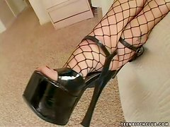 Tommie Ryden the hot babe in fishnets rides a dick