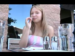 Naughty Nikkie is sitting in a cafe and shows her small teen boobs
